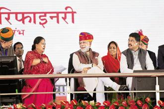 Prime Minister Narendra Modi with Rajasthan chief minister Vasundhara Raje (left) and petroleum minister Dharmendra Pradhan (right) in Barmer on Tuesday. Photo: PTI