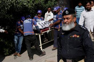 Hasan Zafar Arif's family said there were blood stains on his face and shirt when his body was found. Photo: Reuters