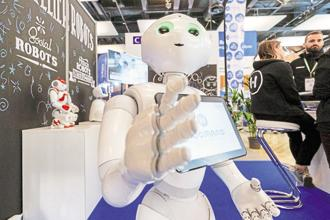 Humanoid robots Pepper (above) and Nao are installed in two Japanese banks, where they perform various customer service functions. Photo: Reuters