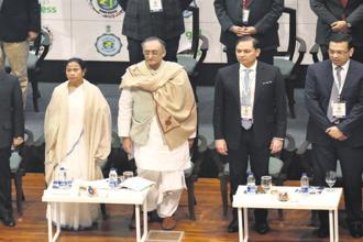(From left) West Bengal chief minister Mamata Banerjee with state finance minister Amit Mitra and Pranav Adani, managing director of Adani Wilmar, at Bengal Global Business Summit 2018 in Kolkata on Wednesday. Photo: Indranil Bhoumik/Mint