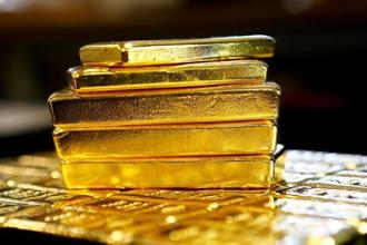 Spot gold was down 0.3% at $1,334.86 an ounce by 1.12pm, after rising to $1,343.91 earlier in the session. Photo: Reuters
