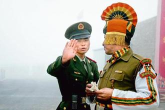 A file photo of Chinese and Indian soldiers at Nathu La border crossing. The face-off situation that had arisen in the Doklam region last year was resolved following India-China talks. Photo: AFP