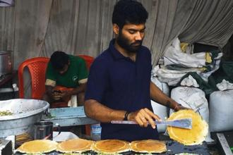 'Avarebele dosas' being made at the 'avarebele mela' in Bengaluru. Photo: Samar Halarnkar