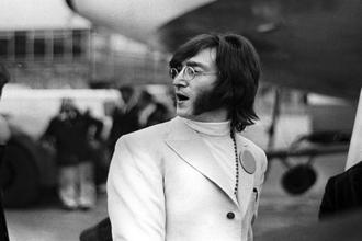 John Lennon at Heathrow Airport before heading to India in February 1968. Photo: Alamy