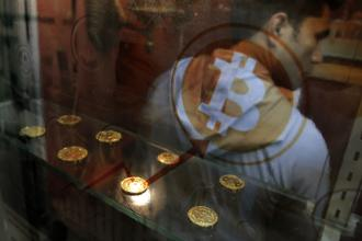 Hacks involving cryptocurrencies like bitcoin have cost companies and govts $11.3 billion through lost potential tax revenue from coin sales and illegitimate transactions. Photo: AP