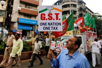 Disruptions from GST and a ban on high currency notes in November 2016 curtailed growth and manufacturing, services and consumer spending. Photo: Reuters