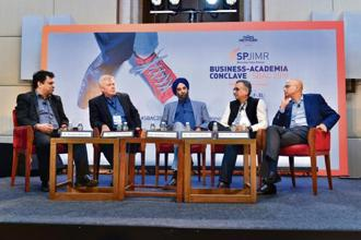 (From left) Larry Paulson, president of Qualcomm India; Mohanbir Sawhney, professor at Kellogg School of Management; Haresh Chawla, partner at True North; and Ananda Mukerji, executive chairman of Anunta Tech, at SBAC2018 in Mumbai.