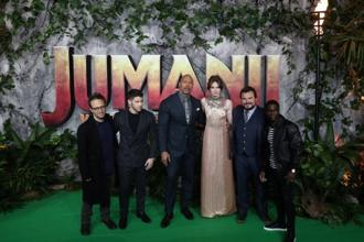 Director Jake Kasdan and cast members pose for photographers as they arrive for the UK premiere of 'Jumanji: Welcome to the Jungle', in central London. Photo: Reuters