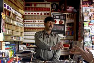 With an aim to curb tobacco consumption—which kills more than 900,000 people each year in India—the government has in recent years raised tobacco taxes, started smoking cessation campaigns and introduced laws requiring covering most of the package in health warnings. Photo: Bloomberg