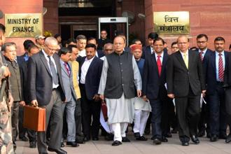 Union finance minister Arun Jaitley leaves along with others from the Ministry of Finance for parliament ahead of Union Budget 2018 on Thursday. Photo: Ramesh Pathania/Mint