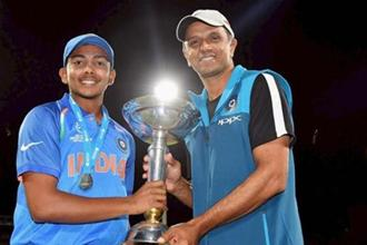 Indian team captain Prithvi Shaw and coach Rahul Dravid pose for photographs with the trophy after winning the ICC Under-19 Cricket World Cup finals in Mount Maunganui on Saturday.  Photo: PTI