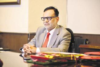 Finance secretary Hasmukh Adhia says notices sent to persons who deposited large sums in banks following demonetization will be taken to their logical conclusion. Photo: Pradeep Gaur/Mint