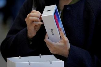 Apple sold 77.3 million iPhones in the key holiday quarter, missing Wall Street expectations of 80 million. Photo: Reuters