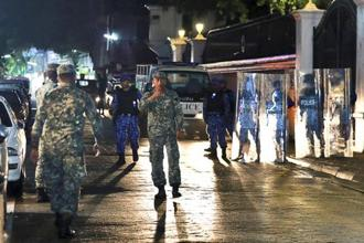 Maldives defence soldiers patrol on the main street of Male, Maldives, on Monday. Photo: AP