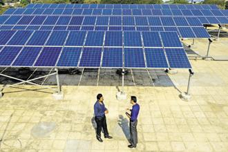 A file photo of solar panels. Vector Green Energy, a company formed by IDFC Alternatives' India Infrastructure Fund II to house its renewable energy investments, made the acquisition. Photo: Abhijit Bhatlekar/Mint