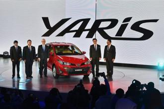 Toyota officials at the unveiling of the company's Yaris concept car at Auto Expo 2018 in Greater Noida on Wednesday. Photo: PTI