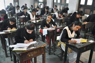 Students appear in the 12th class examination of Uttar Pradesh Board at an examination centre in Moradabad on Tuesday. Photo: PTI