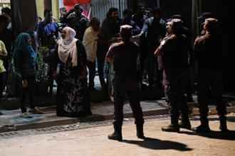 Security forces stand outside Maldivian Democratic Party office as they barricade it in Male, Maldives on Wednesday. Photo: AFP