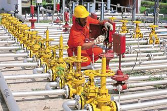 Representational image. An engineer of ONGC works inside the Kalol oil field in Gujarat. Investments into these 60 oil and gas fields will lead to generation of over 88,000 jobs, an official statement said. Photo: Reuters