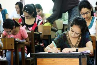 CBSE says Aadhaar is mandatory for all except for those from Assam, Jammu and Kashmir and Meghalaya and the NEET 2018 applicants must give their consent to the CBSE to validate the same. Photo: Hindustan Times