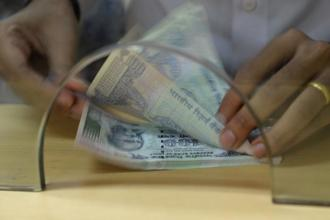 Gross collections before adjusting for refunds stood at Rs8.2 trillion in the April-January period. Photo: AFP