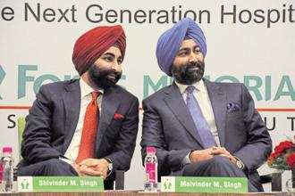 Fortis Healthcare said the meeting of the board of directors for Tuesday will go as scheduled and would consider the resignation of promoters, Malvinder Mohan Singh (right) and Shivinder Mohan Singh from the board. Photo: Parveen Kumar/HT