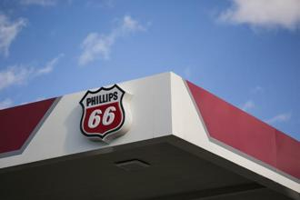 Phillips 66 is buying back the stock for $93.725 a share, in an agreement valued at $3.3 billion. Photo: Bloomberg