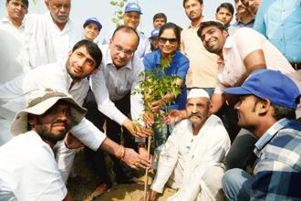Volunteers at a tree plantation drive conducted as part of a joint campaign by HCL Foundation; Give Me Trees, an NGO; and the Noida district administration.