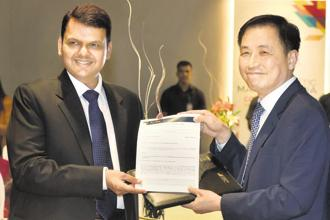 Maharashtra chief minister Devendra Fadnavis with Hyosung chairman and CEO Cho Hyun-joon in Mumbai on Monday. Photo: PTI