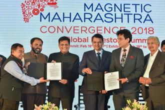 Union railway minister Piyush Goyal (3rd from L), Maharashtra CM Devendra Fadnavis and Maharashtra state industry minister Subhash Desai (R) during an MoU signing ceremony at Magnetic Maharashtra Convergence 2018 in Mumbai on Tuesday. Photo: PTI