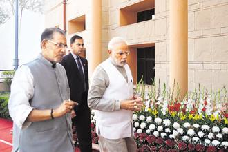Prime Minister Narendra Modi with agriculture minister Radha Mohan Singh at the conference on doubling farmers' income in New Delhi on Tuesday. Photo: PIB