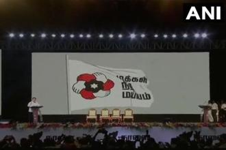 Kamal Haasan unveiled the party name, 'Makkal Neethi Maiyyam' and the party flag in Madurai, Tamil Nadu, today. Photo: ANI/Twitter