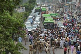 AAP workers block traffic in protest against arrest of party MLA Amanatullah Khan. Khan was expected to be produced before the Tis Hazari court later in the day. Photo: PTI