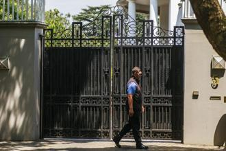 A security guard patrols outside the residence of the Gupta family in Johannesburg, on 14 February. Photo: Bloomberg