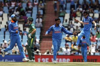 India's captain Virat Kohli (left) and wrist-spin duo of Kuldeep Yadav (centre) and Yuzvendra Chahal celebrate a South Africa dismissal. Photo: AP