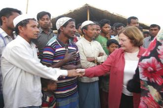 Noble laureate from Mairead Maguire shakes hand with Rohingya refugees during her visit to Kutupalong refugee camp near Cox's Bazar, with fellow laureates Tawakkol Karman and  Shirin Ebadi on Sunday. Photo: AP