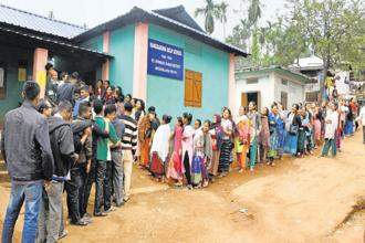 Voters line up outside a polling station in Ri-Bhoi, Meghalaya, to cast their votes in the assembly elections on Tuesday. Photo: PTI