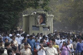 People came from as far as Karnataka and Chennai to catch the last glimpse of Sridevi who will be cremated in Mumbai's Vile Parle crematorium. Photo: AP