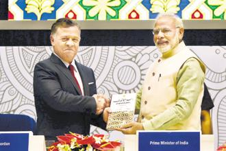 Prime Minister Narendra Modi presents an Urdu translation of 'A Thinking Person's Guide to Islam', a book written by Jordanian prince Ghazi bin Muhammad, to Jordan's king Abdullah II in New Delhi on Thursday. Photo: PTI
