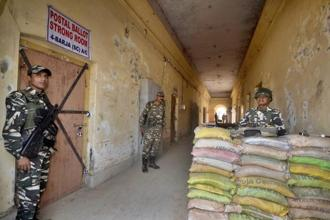 Security forces guard outside a postal ballot strong room after voting for the Tripura elections in Agartala. Photo: PTI