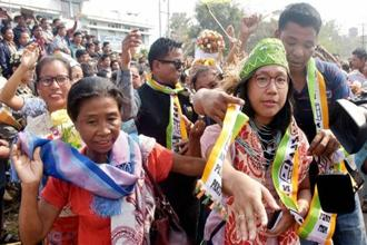 NPP candidate Agatha Sangma celebrates her victory in Tura on Saturday.  Meghalaya threw up a fractured mandate with the Congress emerging as the largest party, marginally ahead of its rival, the NPP. Photo: PTI