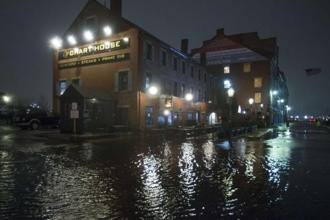 Flooding along Long Wharf as high tide approaches during a large coastal storm on Friday in Boston, Massachusetts. Photo: AFP