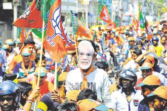 The BJP's audacious display in unseating the five-term Left regime led by the popular Manik Sarkar can compare to the compelling regime change effected by TMC—when they ejected the Left Front that had ruled West Bengal for 35 years. Photo: Reuters