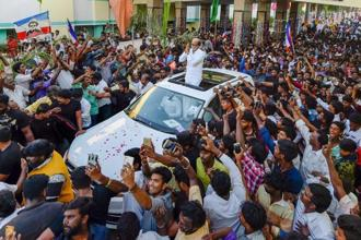 Superstar Rajinikanth, who has announced his intent to contest the assembly polls, greets his fans after unveiling a statue of former chief minister and his super-senior in the film industry, M.G. Ramachandran in Chennai on Monday. Photo: PTI