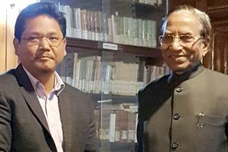 NPP leader Conrad Sangma meets Meghalaya governor Ganga Prasad at Raj Bhawan in Shillong on Sunday, submitting a letter of support from 34 MLAs, including 19 from NPP, six from UDP, four from PDF, two each from HSPDP and the BJP, and an independent. Photo: PTI
