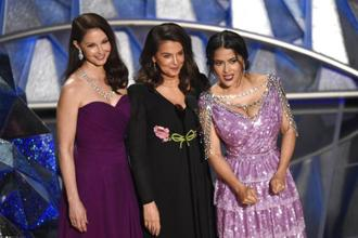 "Three of Harvey Weinstein's accusers, Ashley Judd, Annabella Sciorra and Salma Hayek, took to the stage to present a montage of ""trailblazers"" that included Kumail Nanjiani and Daniela Vega. Photo: AP"