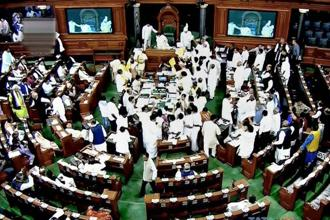 Opposition members protest during the ongoing budget session of Parliament in Lok Sabha in New Delhi on Monday. Photo: PTI