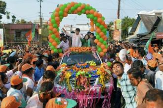 Biplab Kumar Deb with party supporters celebrate party's victory in the state Assembly election during 'Vijoy' rally, in Agartala on Sunday. Photo: PTI