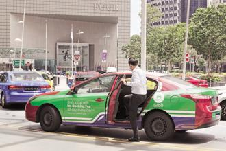 Under a scenario being considered, Uber's stake in Grab is likely to be in the high teens or 20%. Photo: Bloomberg
