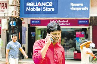 RCom is selling assets, including spectrum, telecom towers and optical fibre network to Reliance Jio to raise funds and repay its Rs45,000 crore debt. Photo: Bloomberg